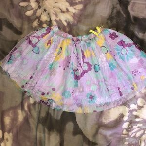 Purple tutu with flowers and butterflies on it
